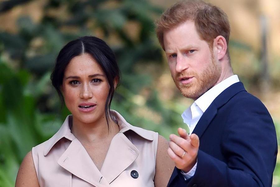 Il principe Harry con la moglie (Ansa)