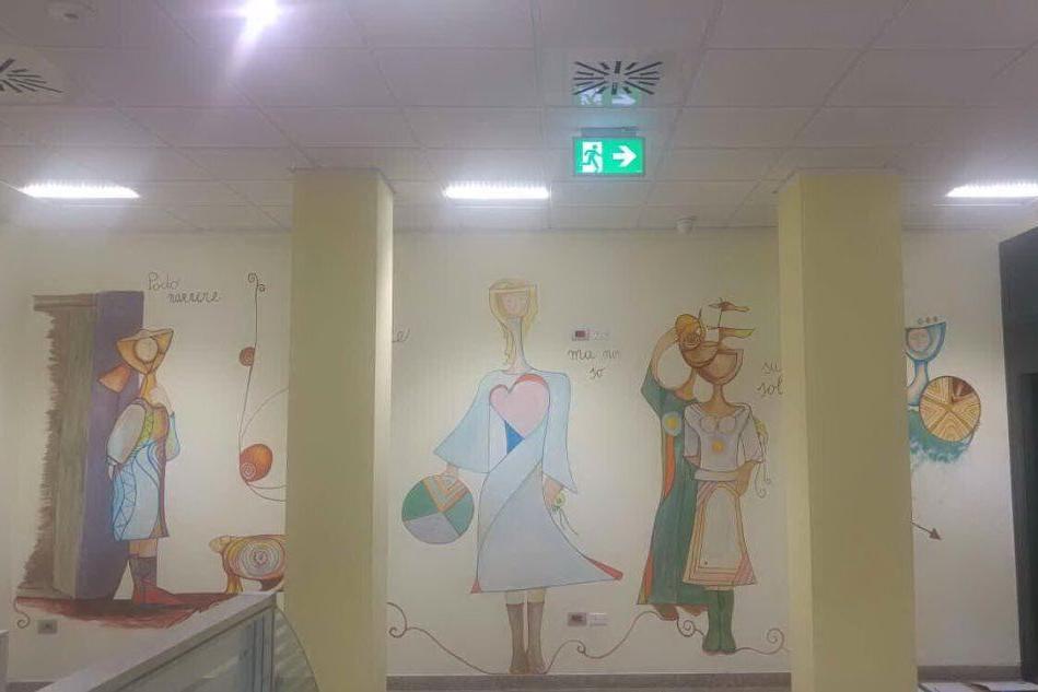 Orgosolo, l'arte di Teresa Podda colora i muri della banca
