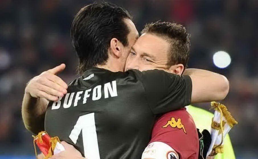 Insieme a Francesco Totti (archivio L'Unione Sarda)